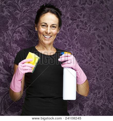 portrait of a middle aged woman ready to clean against a vintage background