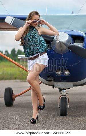 Woman Near Airplane