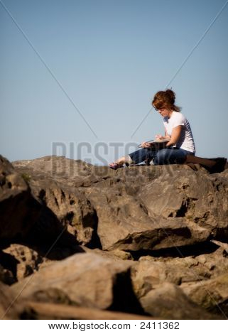 Artist On Boulders