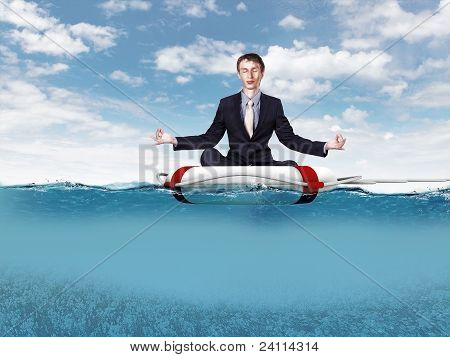 Businessman meditating on the rescue ring