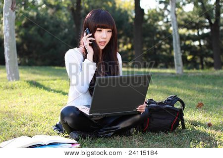 A Asian Student Talking On The Phone