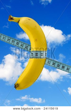 Banana With Measure Tape On Sky Background