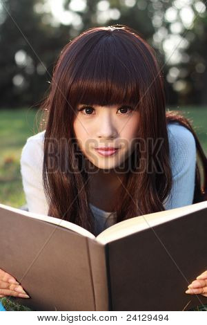 Studying Happy Young Woman Reading Her Book.