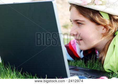 Young Girl And Laptop