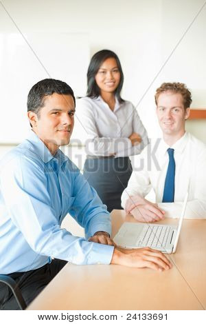 Latino Man Leading Business Meeting