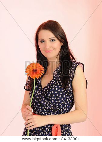 Beautiful Woman With Orange Flower