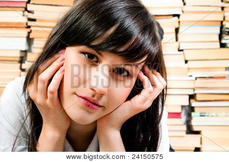 Young Student Reading A Book In The Library