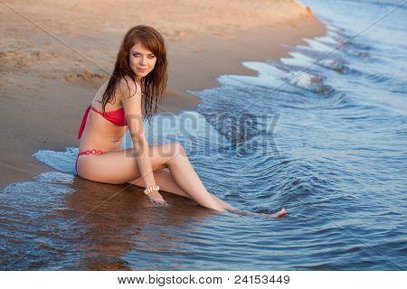 red haired woman wearing bikini