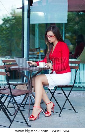 businesswoman  in outdoors cafe