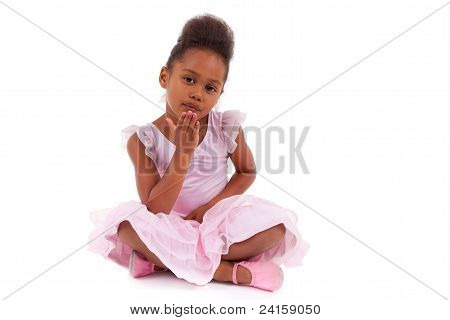 Cute Little African Asian Girl Sitting On The Floor