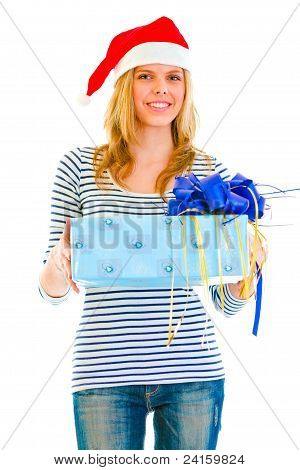 Pretty Teen Girl In Santa Hat Presenting Gift