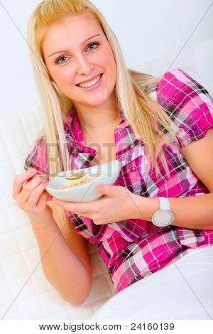 Portrait Of Pretty Woman Eating Muesli