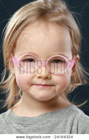 Cute Little Girl Portrait In Pink Glasses
