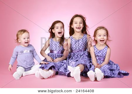 Four Happy Young Girl In Violet Dress Laugh