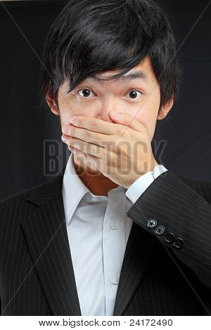 Scared Adult Man With Hand Covering Mouth