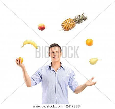 Smiling handsome man juggling fruits isolated on white background