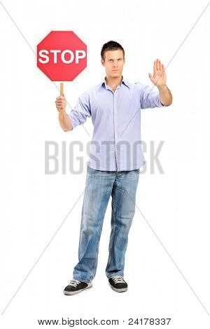 Full length portrait of a man gesturing and holding a traffic sign stop isolated on white background
