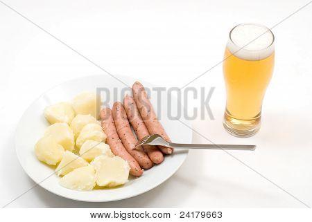 Boiled potato and sausage