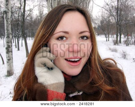 Girl In The Winter In Park Speaks By Phone