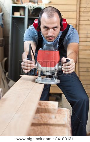Worker With A Router, Vertical.