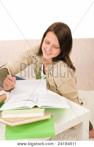 Student Teenager Girl Write Homework With Book