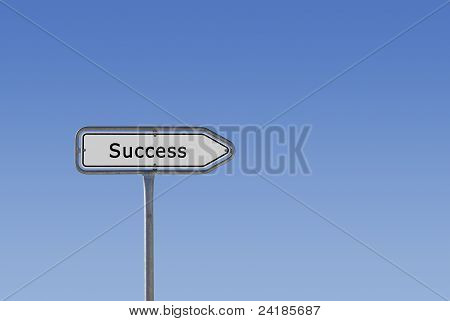 Success sign on signpost