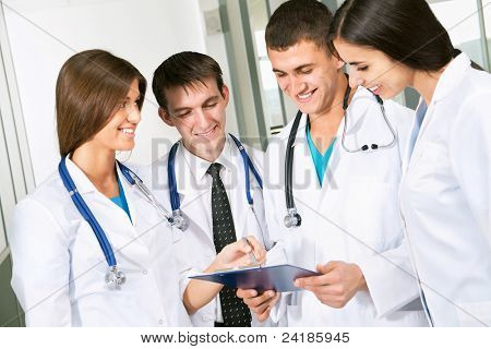 Young doctors are standing inside the hospital