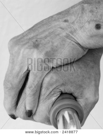 Elderly Hands Holding Cane