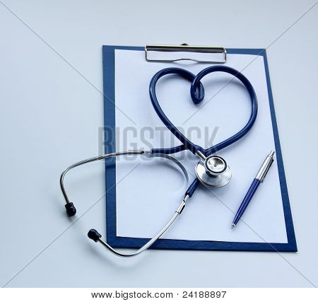 Blank clipboard with modern stethoscope shaped as heart isolated on blue