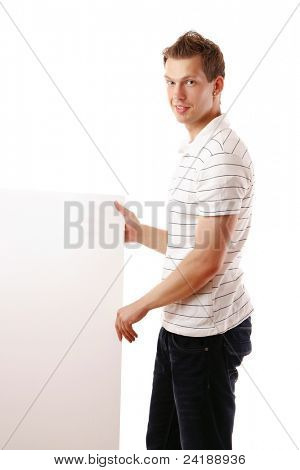 Smiling youn guy with blank banner isolated