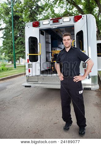 Happy ambulance driver standing for a portrait outdoors