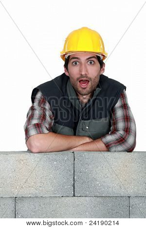 Surprised bricklayer