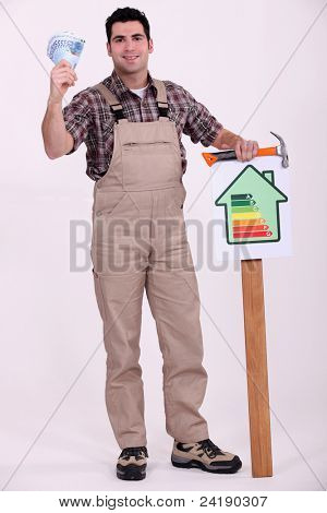 Construction worker holding an energy efficiency rating chart and money
