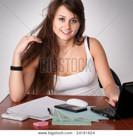 Portrait of enterprising businesslike woman secretary sitting at her workplace