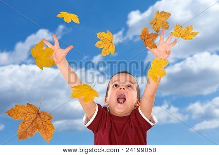 Boy Reaching For The Falling Autumn Leaves