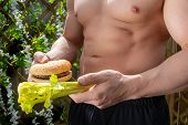 Fitness Montage With Healthy Choice Dilemma Between Fast Food Burger And Healthy Celery Being Held B poster