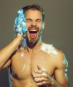 Muscular Attractive Bearded Man Taking Shower. Portrait Of Handsome Sexy Man With Naked Upper Body T poster