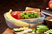 School Or Picnic Lunch Box With Sandwich And Various Colorful Vegetables And Fruits On Wooden Backgr poster