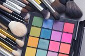 Beautiful Makeup Background. Makeup Brush On Colorful Makeup Palette With Copyspace. poster