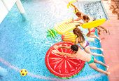 Top View Of Active Friends Jumping At Swimming Pool Party - Vacation Concept With Happy Guys And Gir poster