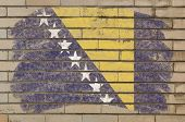 Flag Of Bosnia And Herzegovina On Grunge Brick Wall Painted With Chalk