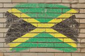 Flag Of Jamaica On Grunge Brick Wall Painted With Chalk