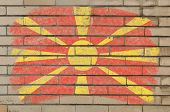 Flag Of Macedonia On Grunge Brick Wall Painted With Chalk