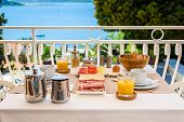 Continental Morning Breakfast Table Setting With Sea View Is Served. poster