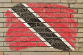 Flag Of Trinidad And Tobago On Grunge Brick Wall Painted With Chalk