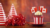 Red And White Theme Cupcakes With Canadian Maple Leaf Flags For First Of July Canada Day Or Canadian poster