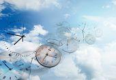 Clocks in blue sky. Time flies poster