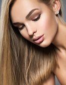 Portrait of  a beautiful young woman with long light straight  hairs and brown make-up.   Pretty gor poster