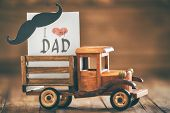 Happy fathers day! Postcard on background of wooden table. poster
