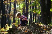 Activity And Active Rest For Kid. Small Boy Play In Autumn Forest. Autumn Vacation And Camping. Litt poster